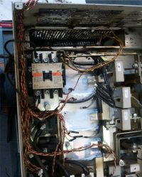 BEFORE: An industrial AC drive that was sent to us for repair.